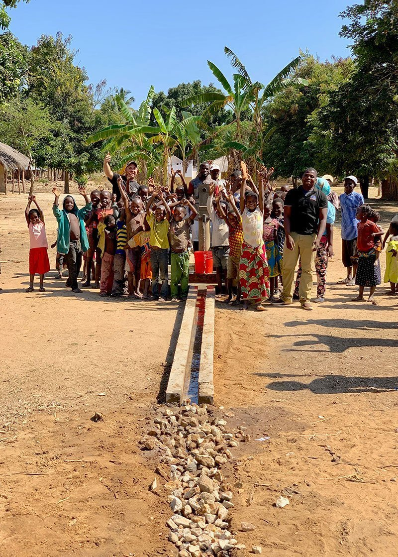 A community enjoys their newly restored well in Montepuez Mozambique Africa