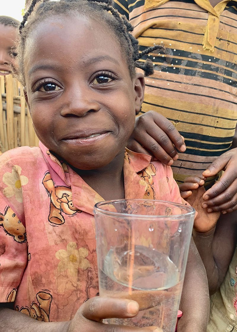 Child drinks from a newly restored well in Montepuez Mozambique Africa